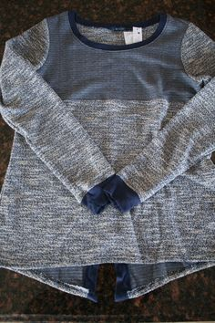 Benway Split Back Sweater -- looks like a really comfortable around the house type look. Love the different patterns it has