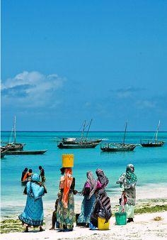 Women waiting for their (fisher)men on Zanzibar beach.  Photograph bygeravodeli