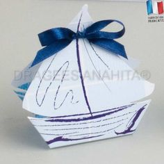 Trés belle boites à dragées en forme de bateau idéal pour un événement sur le thème de la mer