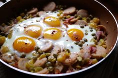Baked Eggs over Bratwurst and Potatoes