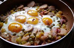 Baked Eggs over Bratwurst and Potatoes