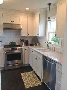 Photo gallery of remodeled kitchen features CliqStudios Dayton Painted White cabinets and island seating
