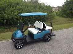 Custom ClubCar with custom paint, wheels, tires, and interior