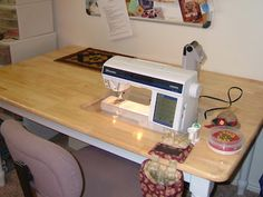 drop-in sewing machine table. Use a dinning room table with cut out