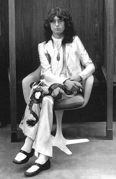 Jimmy Page, 1977. This is a very serious photo of him, when he was in his heavy drug use days.