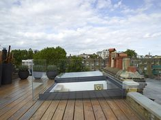 Sliding over rooflight to provide access and natural ventilation. Project by Stephen Fletcher Architects