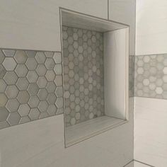 Wavy large tile with a fab hexagon Carrara marble band. Wavy large white tile with a fab hexagon Carrara marble band. Shower Accent Tile, White Tile Shower, White Bathroom Tiles, Bathroom Floor Tiles, Large Tile Shower, Carrara Marble Bathroom, Shower Backsplash, Shower Floor Tile, Bathroom Colors