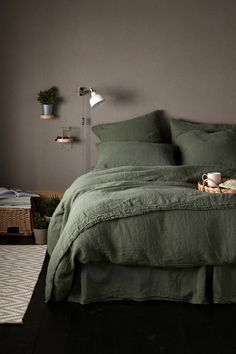 Rich Olive green bedding made from linen. Forget the ironing and enjoy a li. - Rich Olive green bedding made from linen. Forget the ironing and enjoy a lie in in this. team with natural hues, wood and ceramics. Olive Green Bedrooms, Bedroom Green, Dream Bedroom, Home Bedroom, Olive Bedroom, Bedroom Ideas, Bedroom Inspo, Design Bedroom, Woodsy Bedroom