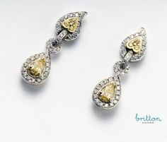 An incredible pair of earrings! Britton Diamonds flame collection, Earrings set with natural fancy yellow diamonds that disperse  warm rays of yellow brilliance. An elegant classic. All centre diamonds are GIA or AGS certified. All diamonds are ethically sourced and comply with the Canadian Jewellers Association code of ethics. #anniversary #yellowdiamonds #earrings #jewelry #BrittonDiamonds