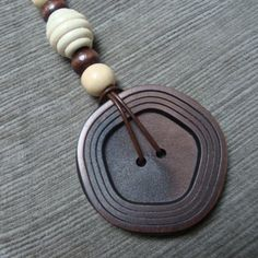 vintage BUTTON up-cycled pendant necklace - unique large coat button & vintage wooden beads made up into a completely OOAK piece on Etsy, $10.00
