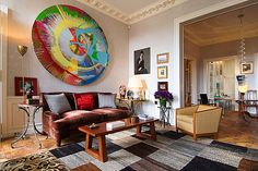 Jacques Grange ~ his apartment in Paris. The painting reminds me of a blown up version of fair spin art. nice mix.