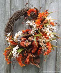 York Autumn Garden Wreath. Foxtails and Pussywillows blend beautifully with an abundant bouquet of lovely fall flower garden favorites set upon a rustic grapevine frame, accented by a posh triple laye