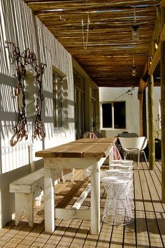 Narrow outdoor table and bench for the cabin porch