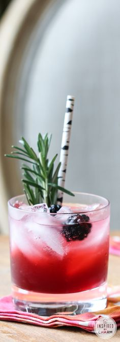 Blackberry Gin Lemonade - Blackberry Lemonade (Recipe), Sparkling Water, Gin, Fresh Blackberries and Rosemary Sprigs for Garnish.