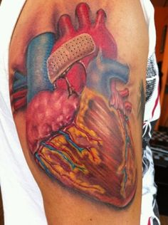 Anatomical Heart Tattoo, love the band-aid on it...has special meaning to me.