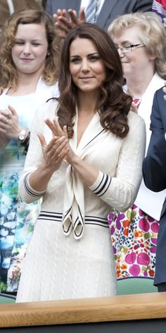 JULY 4, 2012 Catherine took in the Wimbledon Championships wearing the tournament's signature white color, this time re-wearing the Alexander McQueen sailor dress she wore when visiting Prince Edward Island last July 4th (a year to the day!).