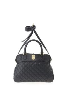 The Whitney bag features top handles, adjustable shoulder strap, and elegant lock hardware. Sleek, structured shape and our luxurious classic quilted leather make it a perfect work accessory. Hardware color varies with bag color. 100% Lamb Leather.14.25