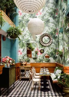 Leo's Oyster bar in San Francisco. The first thing you notice is the custom wild plants wallpaper.