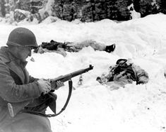 military_history A U. Soldier reloads his Garand rifle after a firefight that left two Germans dead in the snow, Ardennes Great Falls, Military Photos, Military History, American Civil War, American History, Luftwaffe, German Soldier, Ardennes, Montana