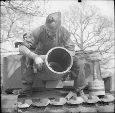 The Churchill AVRE's main weapon was a 29cm Petard spigot mortar. It fired a 40-pound bomb known as the 'Flying Dustbin'.
