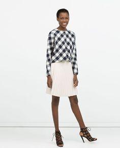 Image 1 of PLEATED SHORT SKIRT from Zara
