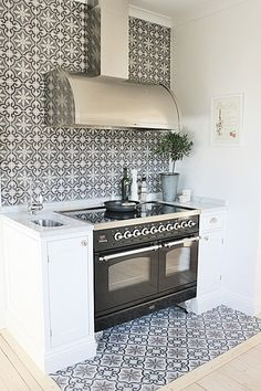 black and white tile in a kitchen. LOVE.