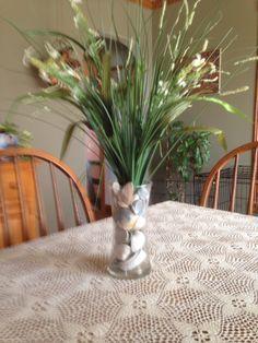 Vase of seashells