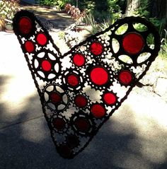 Another beauty by Gioielli.  Bicycle art heart made from recycled cogs gears by VeloGioielli,