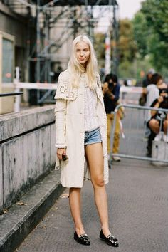 Sasha's off-duty Spring style was gorgeously executed with a textured coat over denim shorts.