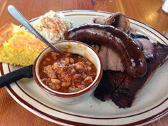 Podnah's/ PITBOSS Combination plate: Ribs, Brisket, Pulled Pork and a Sausage Link. Sides: BBQ Beans and Potato Salad $23.00 | Yelp