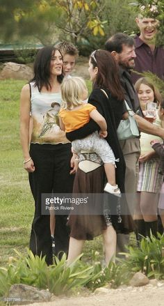 Crown Princess Mary of Denmark talks to her sister Patricia Bailey and holds one of her nephews upon arrival at her cousin Alison Donaldson's wedding March 12, 2005 in Swansea, Australia. Crown Prince Frederik and Princess Mary are on their first day holiday after their official visit of Australia