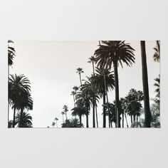 Los Angeles sunset sky filled with palm trees print on a rug. California sunset home decor. Welcome mat.