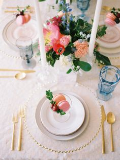 place setting with macarons - photo by Allison Marie Photography http://ruffledblog.com/wedding-inspiration-at-longview-mansion