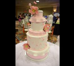 The University of Akron Quaker Station Show Gallery - Today's Bride Photo Gallery: We're absolute in love with this pink cake from http://www.acmestores.com/acme-fresh-market-cakes/!