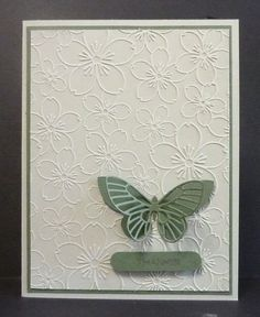 By Jo Laughlin (Reddyisco at Splitcoaststampers). The Darice flower embossing folder is featured as is a Memory Box butterfly die-cut. Striking in its simplicity!