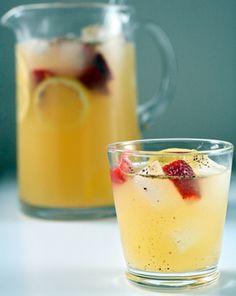 Peppery Punch with OJ, Lemon Juice, Sugar, Elderflower Liqueur, Champagne, Gin (or Vodka), with Strawberries, Lemons, & Freshly Ground Pepper Garnishes