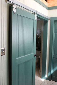 I love the idea of a sliding barn door - especially in a pop of color! Sliding Door Hardware, Sliding Doors, Barn Door In House, Barn Door Designs, Laundry Room Doors, Interior Barn Doors, Pink Wallpaper, Decoration, Home And Living