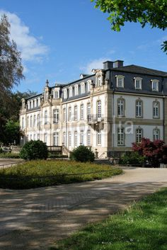 Buesing palace in Offenbach at the Main Hesse Germany is build in the 1770th and a classic example of neo-Baroque architecture. It is now used as a hotel and congress centre. View from the garden.