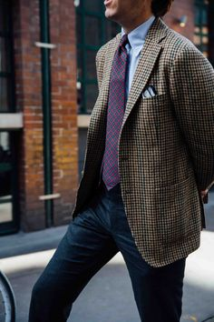 Tweed houndstooth sport coat, white shirt with light blue dress stripes, red tie with navy medallions, navy pants