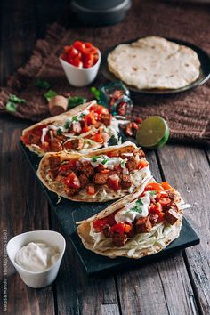 Delicious tacos with spicy tofu, cherry tomatoes, onion and salad