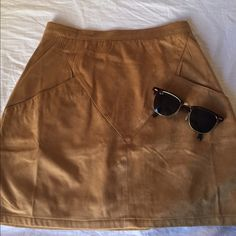 NWT LF Suede Skirt Never worn! My mom just bought me the wrong size. Camel suede high waisted skirt. LF Skirts