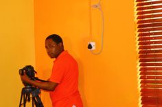 Crew member, Bayo Success setting up his camera before commencement of recording