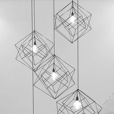 The skeleton chandelier comprises of three cubes each made from square steel. The central cube is free-floating and frames the large carbon filament lamp inside. Entrance Lighting, Hall Lighting, Entrance Hall, Lighting Design, Black Ceiling, Metal Chandelier, Steel Structure, Cube, Ceiling Lights
