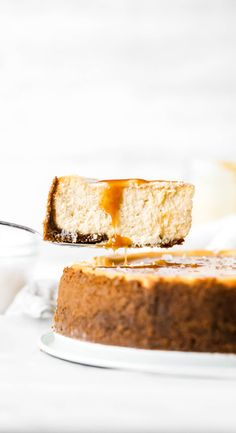 This salted caramel cheesecake is seriously the best cheesecake recipe ever. It's silky smooth, extra creamy, and covered in a delicious homemade salted caramel. You definitely need to make this! #cheesecake #saltedcaramel #cheesecakerecipe #butternutbakery