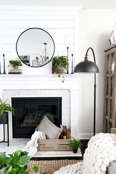 Plum Pretty Decor & Design Co.Spring Living Room Update with HomeGoods — Black Swing arm lamp and a modern farmhouse fireplace. Spring Living Room Update with HomeGoods- Modern Farmhouse Living Room by Plum Pretty Decor & Design Co. Farmhouse Fireplace, Home Fireplace, Fireplace Design, Fireplace Ideas, Modern Fireplace Decor, Tile Around Fireplace, Modern Mantle, Small Fireplace, Concrete Fireplace