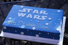 Clean and simple blue buttercream Star Wars birthday sheet cake with white stars