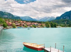SWITZERLAND ~ A beautiful picture of the small village of Interlaken, and the mountains of the Alps from Lake Brienz..........