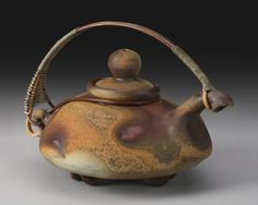 """Richard Bresnahan, Raku  (Yes, Bresnahan's work---St. John's Pottery, Collegeville, MN....I was fortunate to fire one of my pieces in his """"Johanine Kiln"""", holding 10,000 pieces wood fired 24/7 for two weeks....An amazing process....Thanks for sharing....he has  an artistic friend that does these special teapot handles....) Pottery Teapots, Raku Pottery, Ceramic Teapots, Pottery Sculpture, Pottery Designs, Chocolate Pots, Contemporary Ceramics, Pottery Studio, Tea Ceremony"""
