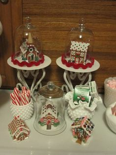 My Gingerbread House display.  Hallmark ornaments under glass domes from Goodwill.  The candlesticks and Hobnail items are also GW finds.
