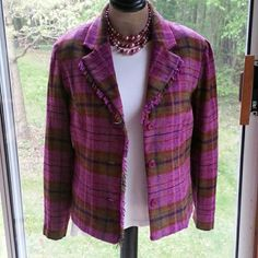 Purple Plaid Blazer This fabulous purpley/ pink plaid blazer features a three button down front with funky fringe and purple satin liner. Lines of green and orange really make it pop! Size medium.  Lightweight and stylish.  Would look great with jeans and a complimentary scarf!! Bundle and save! Thanks for looking! First Option Jackets & Coats Blazers